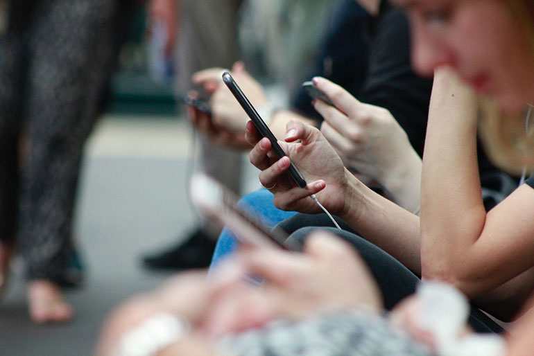 People-spend-a-great-amount-of-time-staring-at-their-phone-and-apps