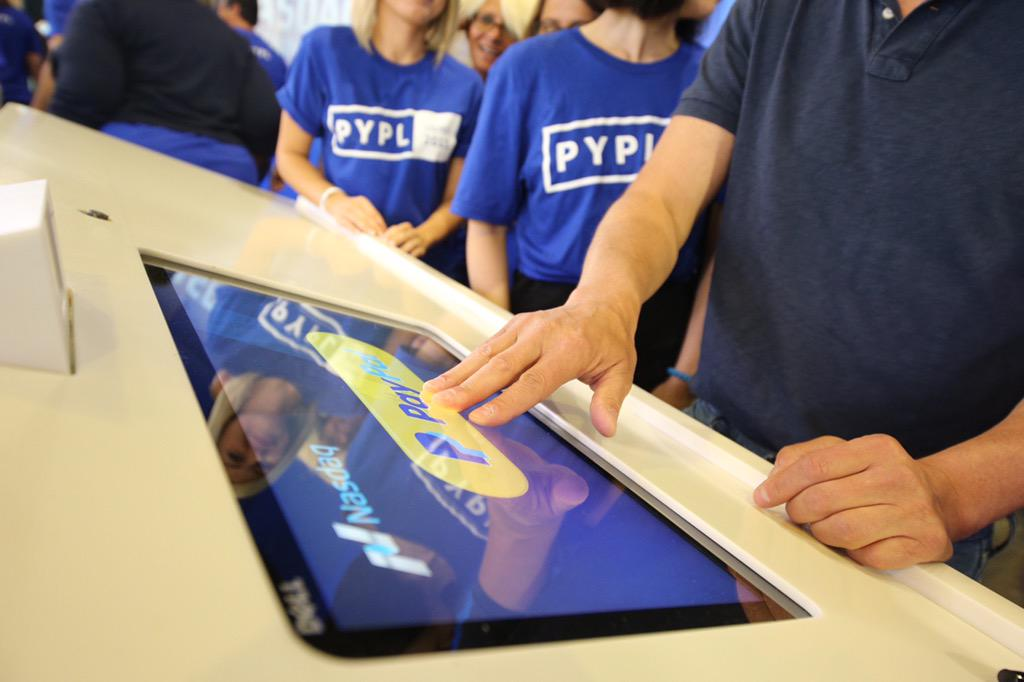 Visitors at conference interact with Paypal product