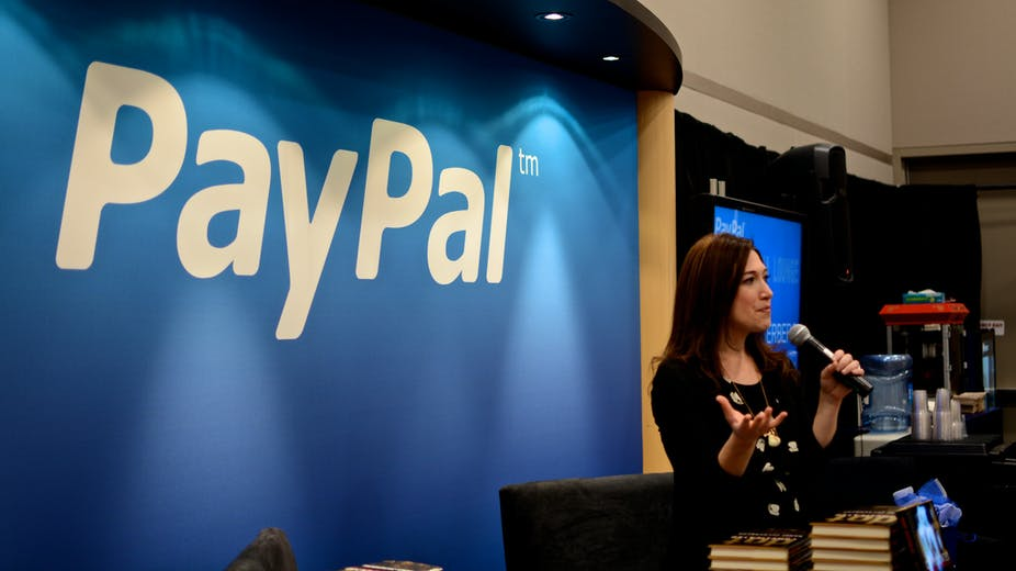 a young lady gives talk at Paypal event