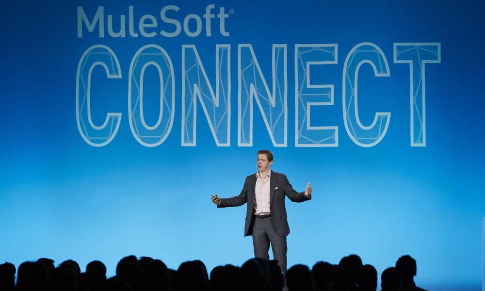 a staff talks at MuleSoft event