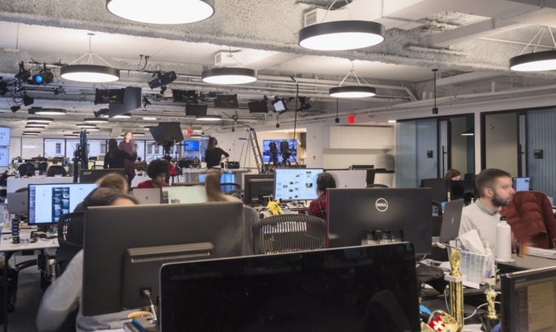 staff work on computer in Business Insider Headquarters