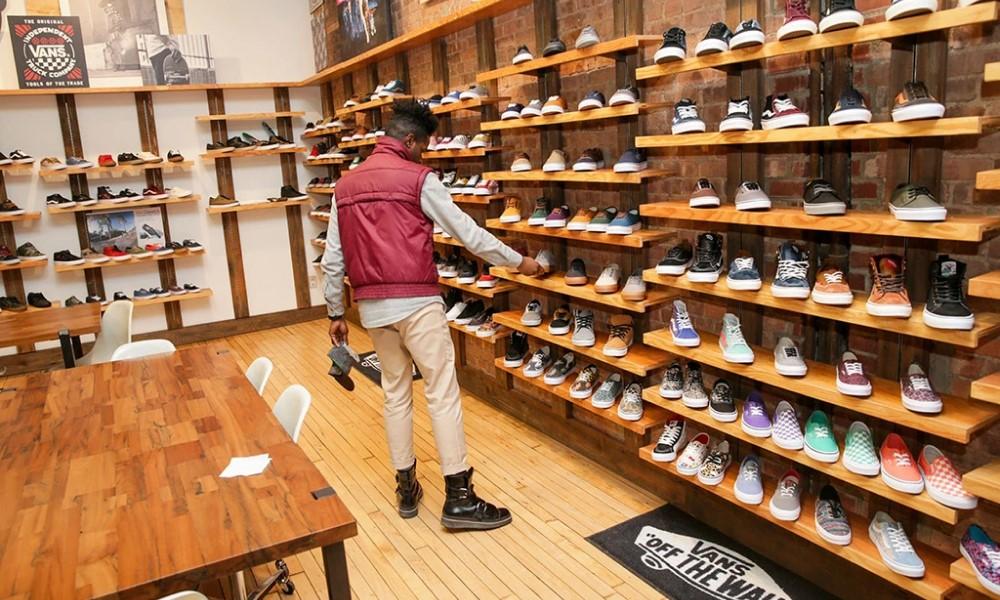 A black man in a Vans store