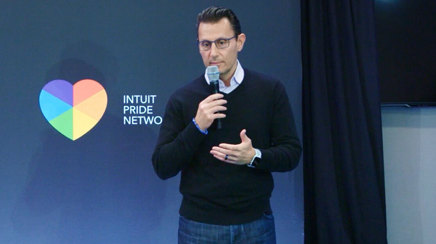 Intuit staff give talk on stage