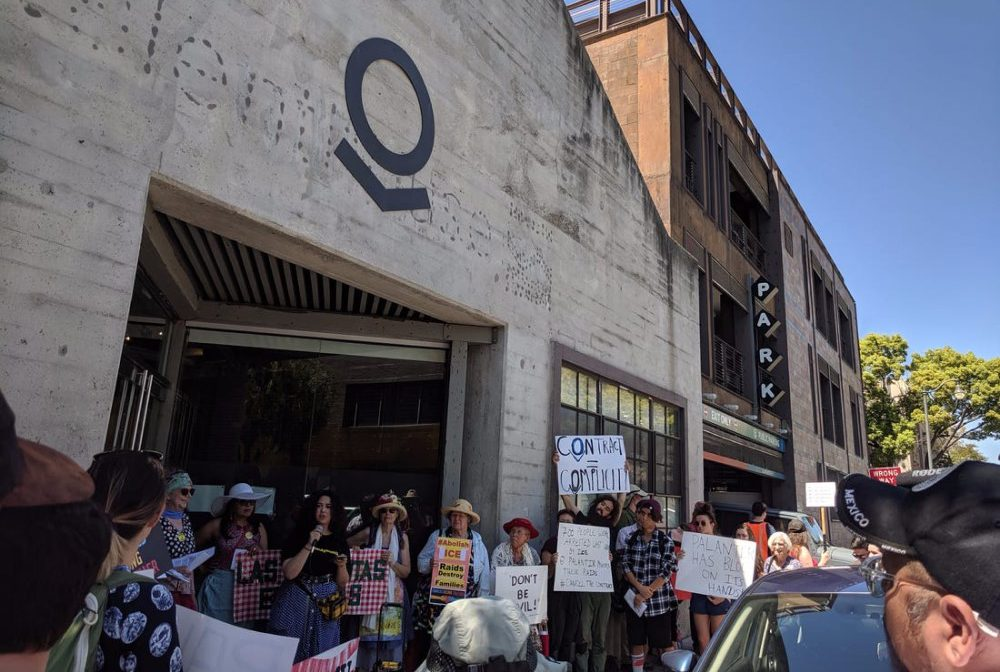 Protestors in front of Palantir office