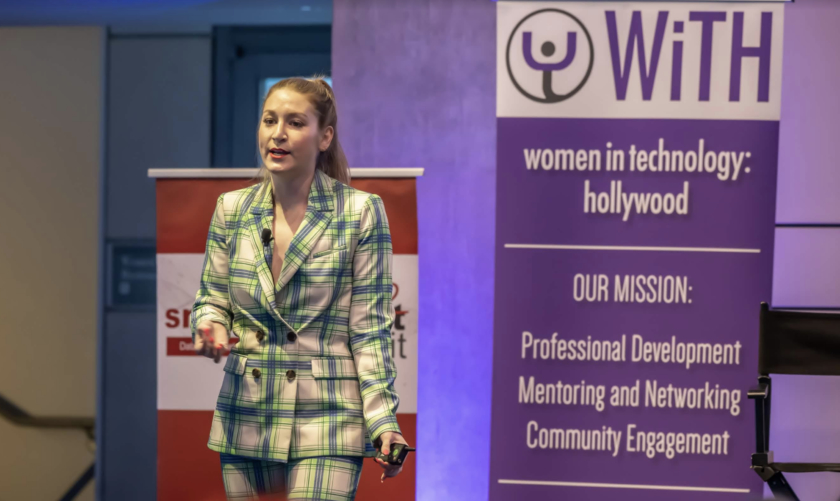 A young lady present on stage at WiTH conference