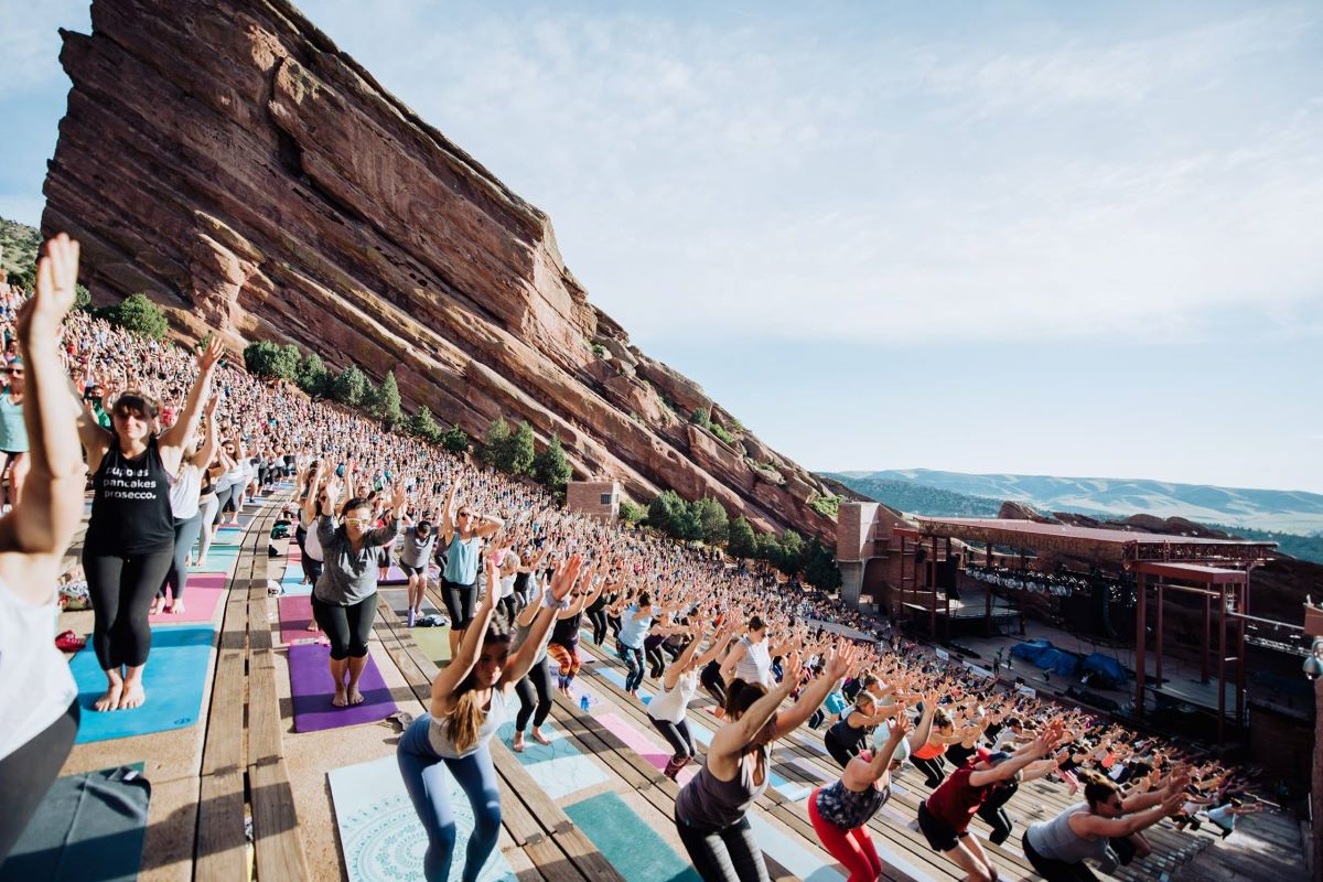 Young people at an outdoor fitness event in Red Rocks park