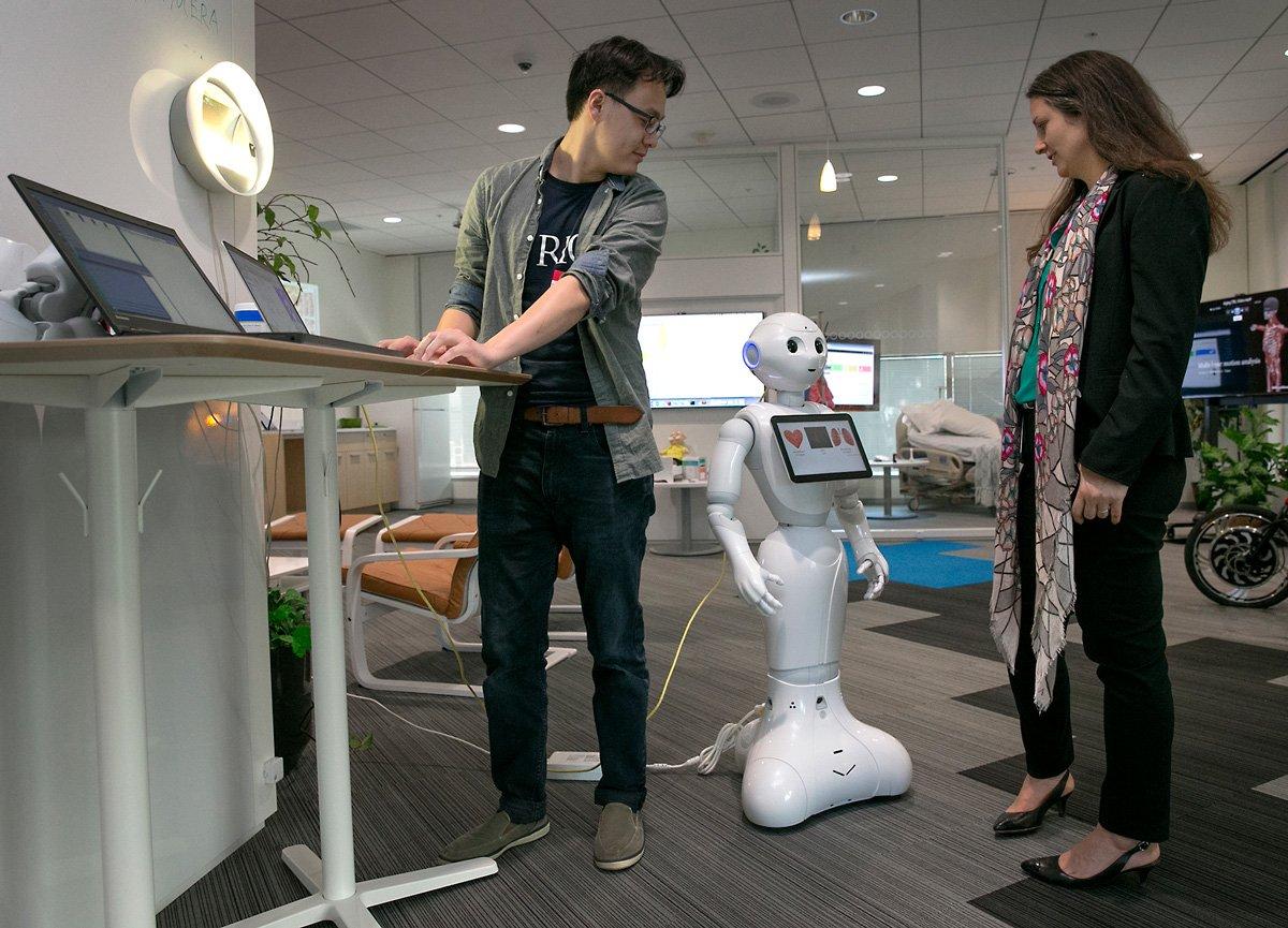 IBM staff work with Robot at IBM office