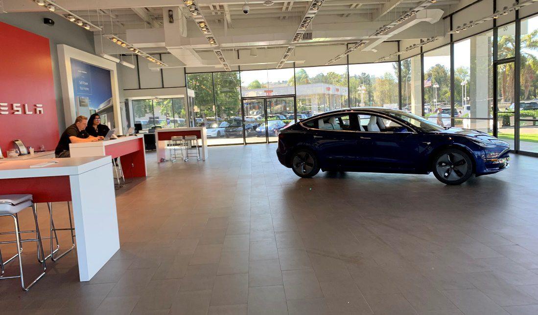 Tesla showroom with consumers