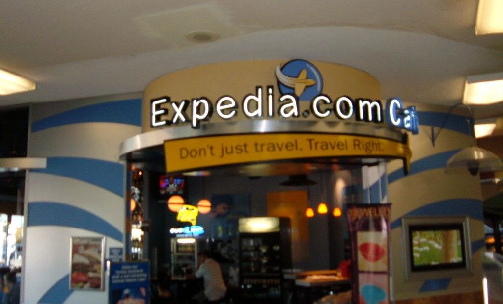 Expedia marketing banner at an airport