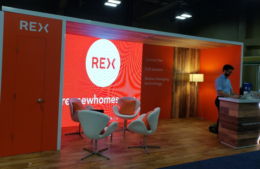 REX staff at a trade show for real estate industry