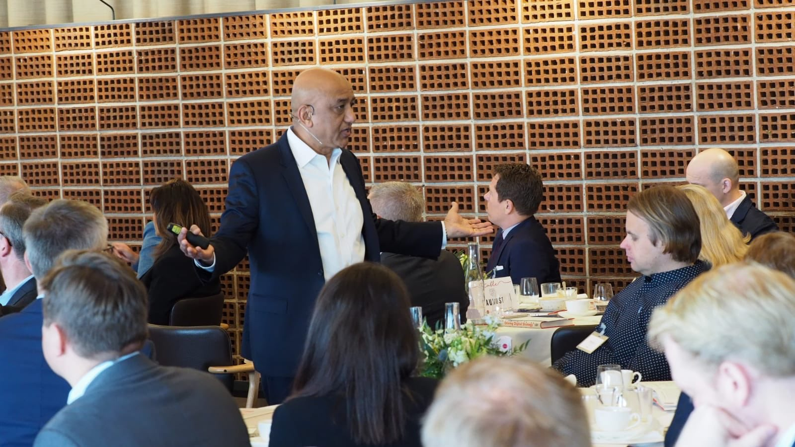 HBR staff collaborate with attendees in a luncheon