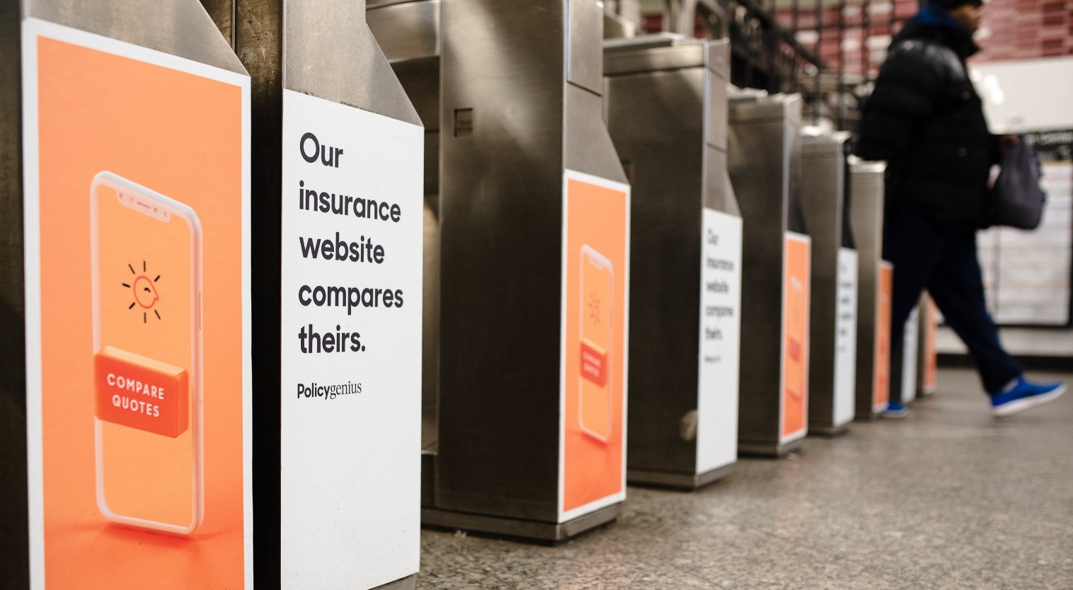 PolicyGenius banner at the airport