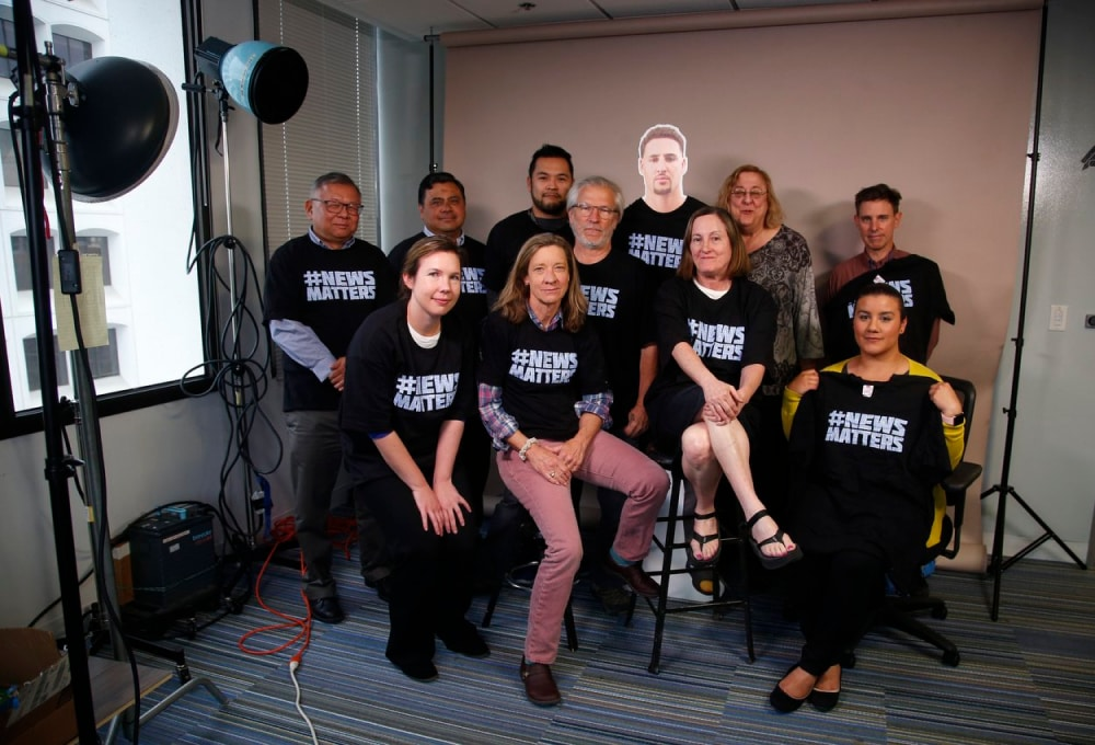 Staff from local news companies in a portrait about freedom of news