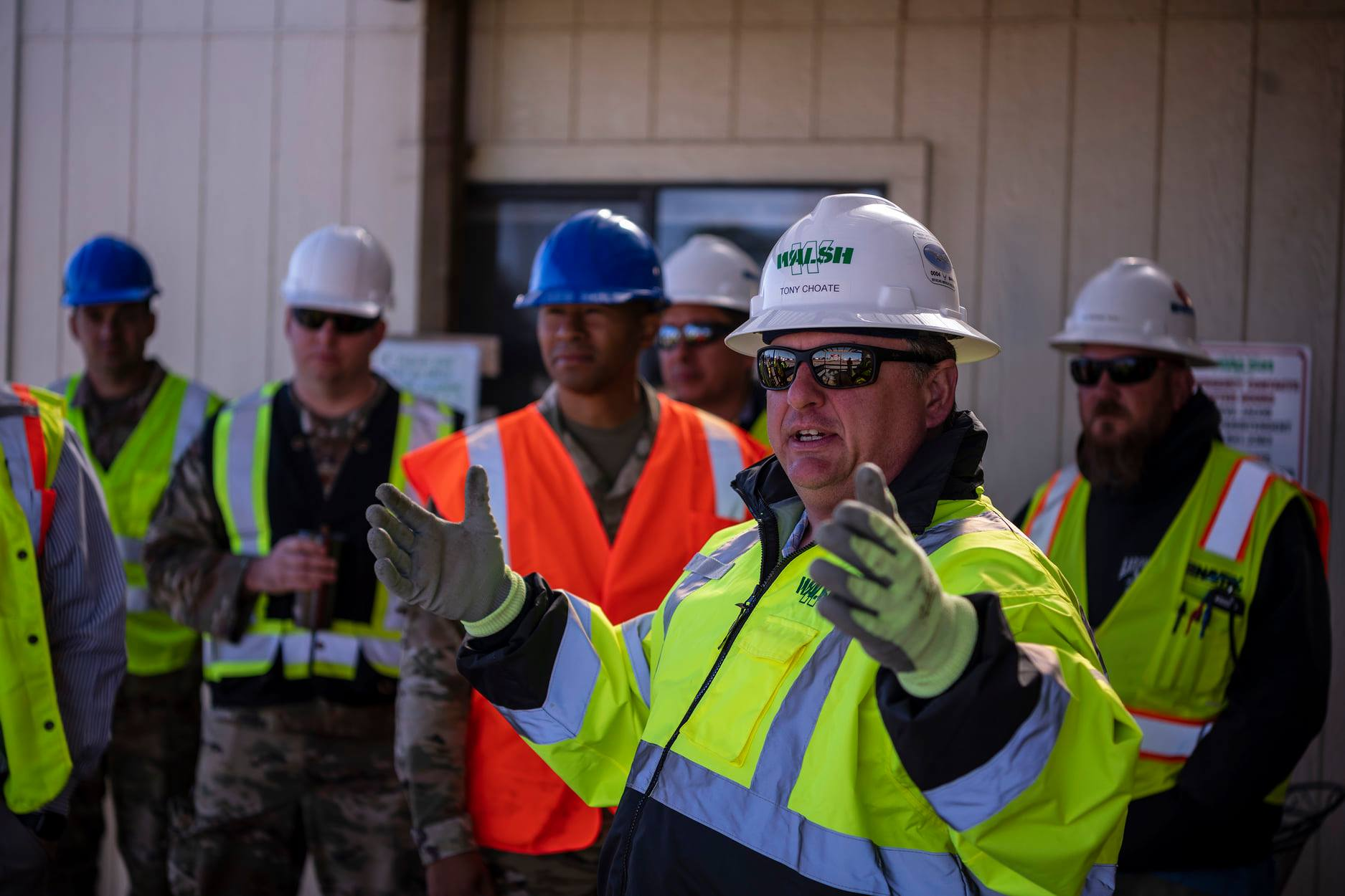 Project manager collaborate with front-line workers at job site
