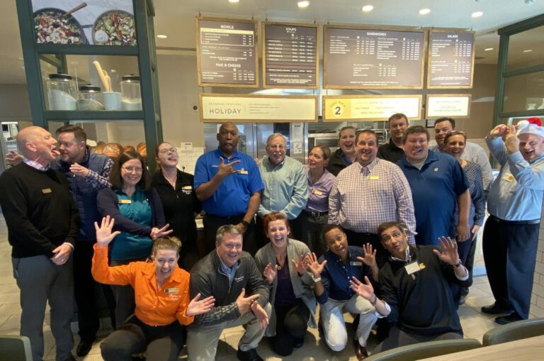 Panera Bread team celebrate in a holiday event